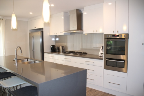"Grey ""Quantam Quartz"" stone benchtop, grey and white kitchen, Westinghouse appliances, reflectionsplashback"